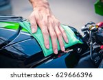 hand with man cleaning... | Shutterstock . vector #629666396