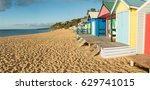 Colourful bathing boxes on Mills Beach in Mornington on the Mornington Peninsula south of Melbourne, Australia.
