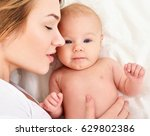 mother and baby playing and... | Shutterstock . vector #629802386