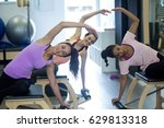 group of women exercising on... | Shutterstock . vector #629813318