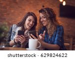 two friends drinking coffee in... | Shutterstock . vector #629824622