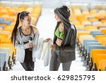 two young sportswomen with... | Shutterstock . vector #629825795