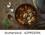 beef stew in a cast iron pan ... | Shutterstock . vector #629903396