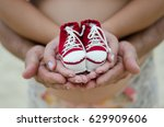 dad  mom and baby shoes | Shutterstock . vector #629909606