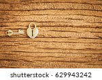 heart shaped lock and key on... | Shutterstock . vector #629943242