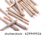pile of cannabis joints at a... | Shutterstock . vector #629949926