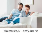 young couple watching content... | Shutterstock . vector #629950172