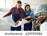 two modern aircraft engineers ... | Shutterstock . vector #629950586