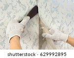hands in glove removing old... | Shutterstock . vector #629992895
