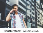 young man talking on the smart... | Shutterstock . vector #630012866
