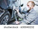 Auto Repairman Grinding...