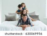 portrait of smiling family... | Shutterstock . vector #630069956