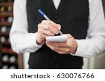 mid section of male waiter... | Shutterstock . vector #630076766