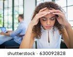 worried woman sitting in a... | Shutterstock . vector #630092828