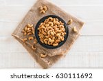 roasted cashew nuts in bowl | Shutterstock . vector #630111692