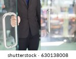 man's hand open the door with... | Shutterstock . vector #630138008