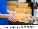 asian woman receiving a package ... | Shutterstock . vector #630238706