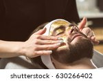 man at beautician's during gold ... | Shutterstock . vector #630266402