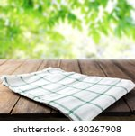 checkered tablecloth on wooden... | Shutterstock . vector #630267908