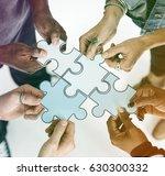 human hands holding jigsaw... | Shutterstock . vector #630300332
