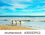 group of surfers ready to surf... | Shutterstock . vector #630332912