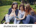 three beautiful girls walking... | Shutterstock . vector #630356402