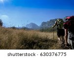 two hikers are climbing... | Shutterstock . vector #630376775