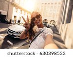 tourist posing for a selfie in... | Shutterstock . vector #630398522
