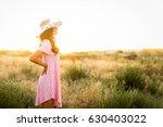model wearing a sun dress and... | Shutterstock . vector #630403022