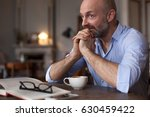 a middle aged man is having... | Shutterstock . vector #630459422