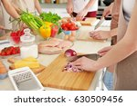 people cutting onion at cooking ... | Shutterstock . vector #630509456