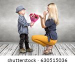 small son gives his beloved...   Shutterstock . vector #630515036
