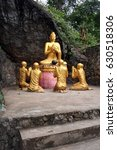Small photo of Gold life size statue of Lord Buddha surrounded by gold students at Phou Si Mountain in Luang Prabang Laos. Inscription relates to embracing the instruction to reach Nirvana.
