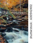 autumn waterfalls in park with... | Shutterstock . vector #630542402