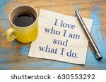 Small photo of I love who I am and what I do - positive affirmation words on a napkin with a cup of coffee