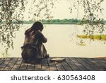 lonely sad woman | Shutterstock . vector #630563408