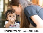 cute asian baby girl give a... | Shutterstock . vector #630581486