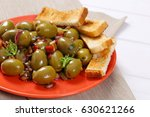 plate of marinated green olives ...