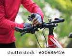 cyclist put the action camera... | Shutterstock . vector #630686426