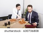 eating pizza at office lunch... | Shutterstock . vector #630736808