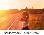 beauty girl outdoors enjoying...   Shutterstock . vector #630738962