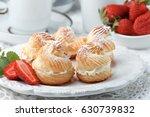 profiteroles with cream ... | Shutterstock . vector #630739832