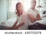 Small photo of Frustrated couple arguing and having marriage problems
