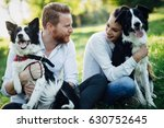 Stock photo beautiful romantic couple in love walking dogs in nature and smiling 630752645
