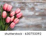 bouquet of pink tulips on grey... | Shutterstock . vector #630753392