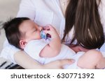 woman and new born boy. baby... | Shutterstock . vector #630771392