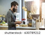 salesman using digital tablet... | Shutterstock . vector #630789212