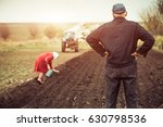workers and tractor on spring... | Shutterstock . vector #630798536