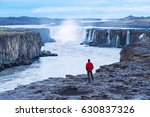 selfoss waterfall. guy in a red ... | Shutterstock . vector #630837326