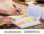 close up of a businessperson... | Shutterstock . vector #630849416